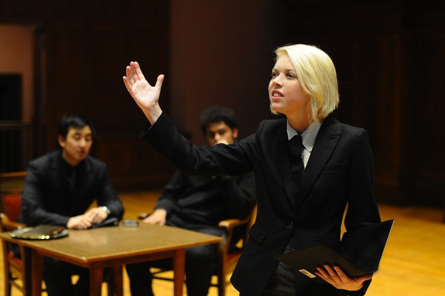 President and Co-Chair Erica Rothberg practices her oratory skills as members of the forensics debate team look on. The team is currently preparing for the National tournament.
