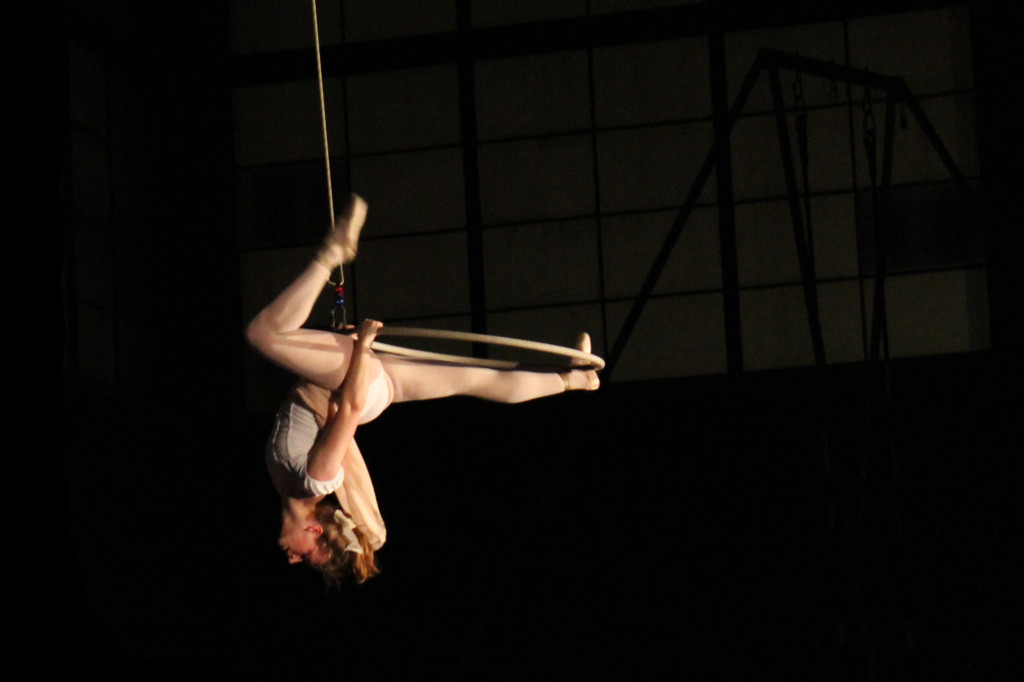 Oberlin College Aerialists, suspended high in the air in Hales Gym, hang upside-down over the audience below. The troupe paid tribute to famous works of art with deft movements and a hint of danger this past Saturday.