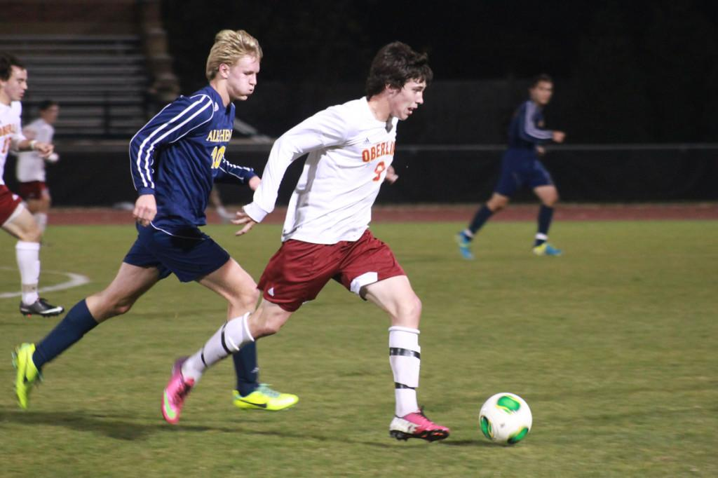 Sophomore John Ingham outruns an Allegheny College opponent. The men's soccer team received an at-large bid to participate in the NCAA national tournament. Their first game is on Saturday in Rochester, New York against the SUNY Oneonta Red Dragons.
