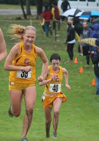 Juniors Sarah Jane Kerwin (left) and Emma Lehmann (right) race to the finish line. Kerwin and Lehmann finished fourth and fifth respectively at the North Coast Athletic Conference Championship meet.