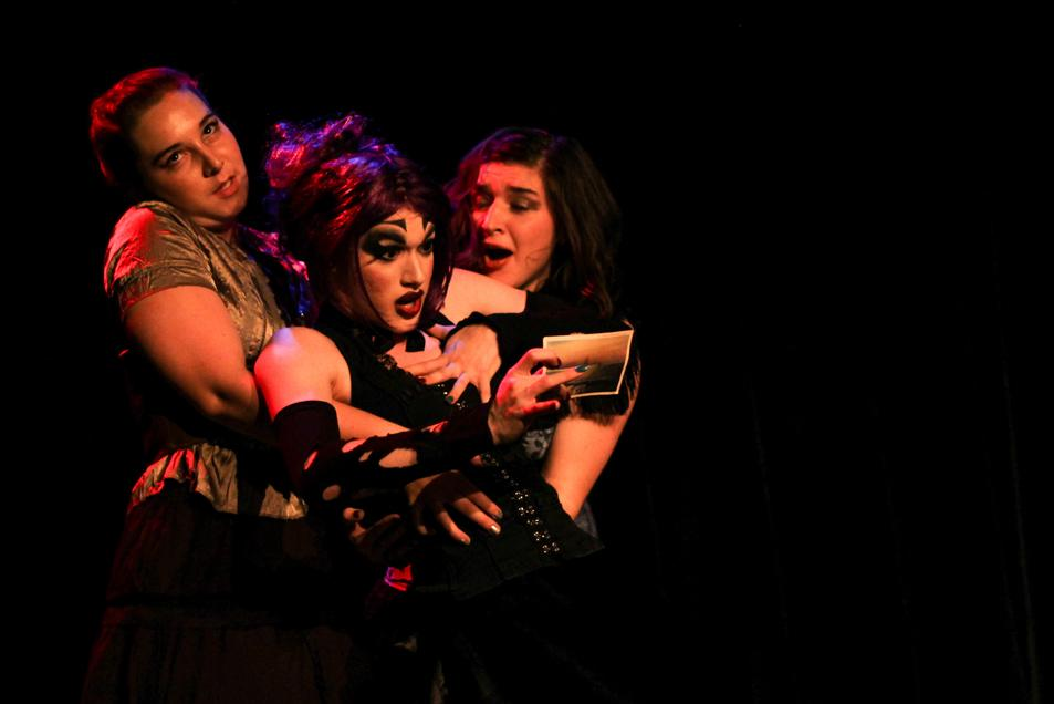 OCircus member College first-year Em Notely is caught by College junior Annie Valocchi as Notley stares in shock at a letter they have just received. The performance ensemble regaled their audiences with plenty of humor and the occasional striptease.
