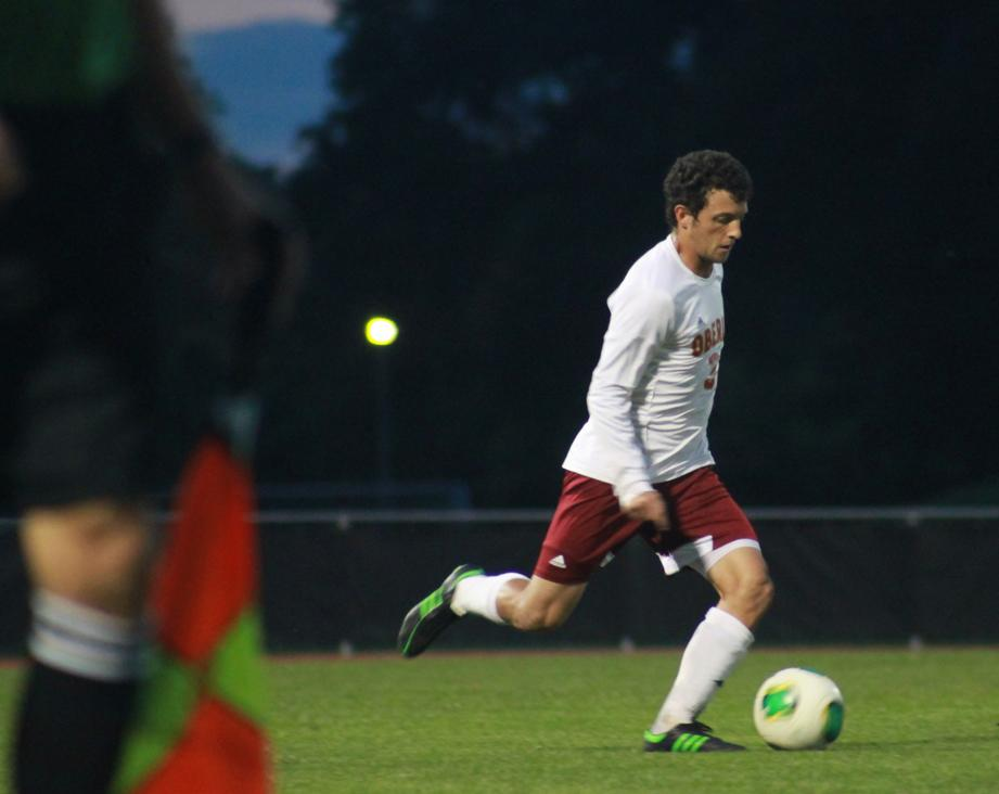 Senior captain Ari Schwartz dribbles the ball. The Yeomen have enjoyed one of their most successful seasons in the last two decades.