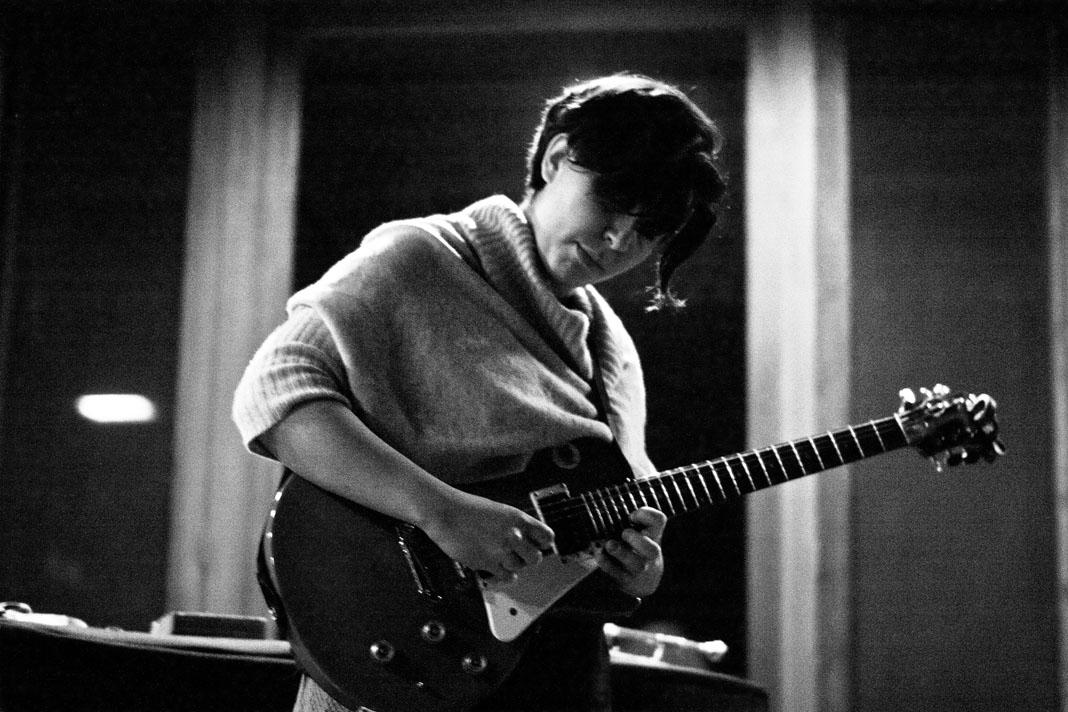 College junior Valerie Perczek takes a guitar solo during Soundfarm's Usonian Solos showcase Saturday. Set in the Weltzheimer-Johnson House, the event featured drums, vocal effects and even bones used to create unique sounds.