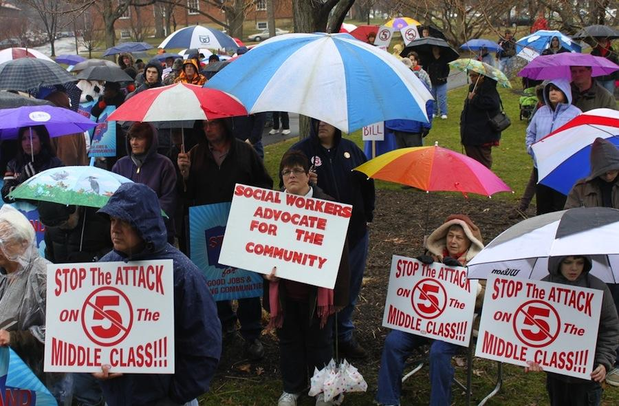 Braving+inclement+weather%2C+over+100+Oberlin+community+members+convened+in+Tappan+Square+to+protest+against+Ohio+Senate+Bill+5.+Professor+of+Politics+and+East+Asian+Studies+Marc+Blecher+expressed+hope+that+such+wide+support+bodes+well+for+a+referendum+to+repeal+the+bill+in+the+fall.