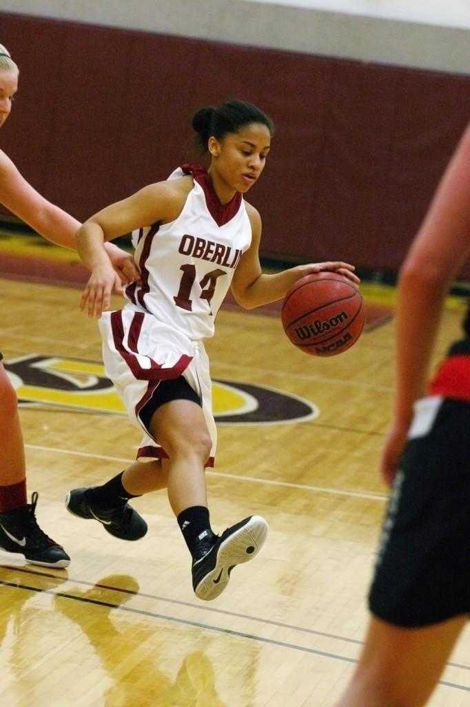 Sophomore Malisa Hoak hunts for the basket against Wooster.