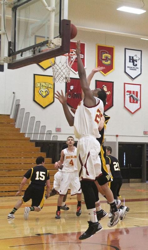 Sophomore center Randy Ollie goes in for a layup against the DePauw University Tigers. Ollie has averaged 10.6 points and 8 rebounds a game this season.