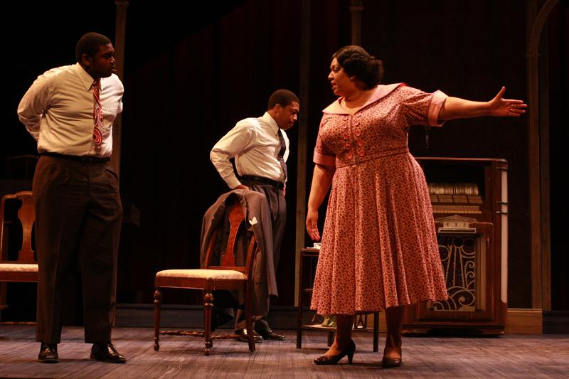 (From left) College senior Brandon Brown as Nellie's husband, College senior Gynarva Monroe as Ossie Brown, and Cleveland-based actress Debra Rose as Nellie share a dramatic moment in Follow Me to Nellie's. The play, which blended romance and small-town political intrigue, was performed at Hall Auditorium last weekend.