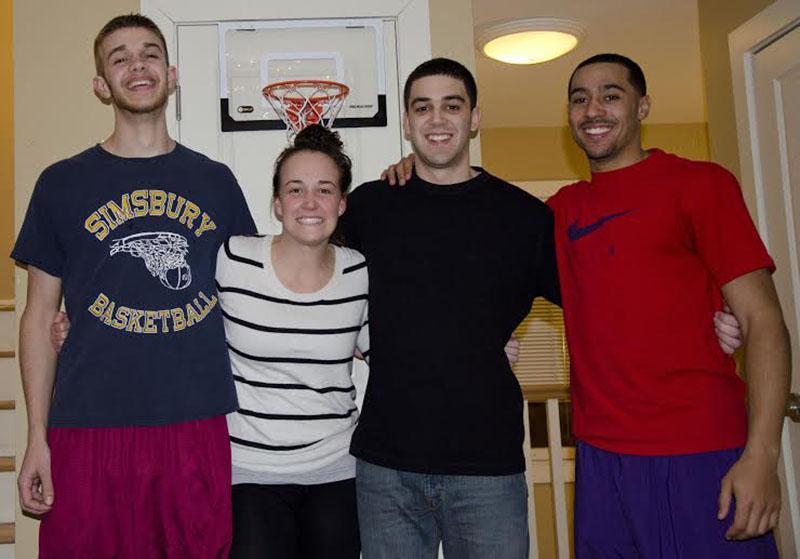 In the Locker Room: Seniors Geoff Simpson (left), Lillian Jahan, Derrick Sant and Emmanuel Lewis.