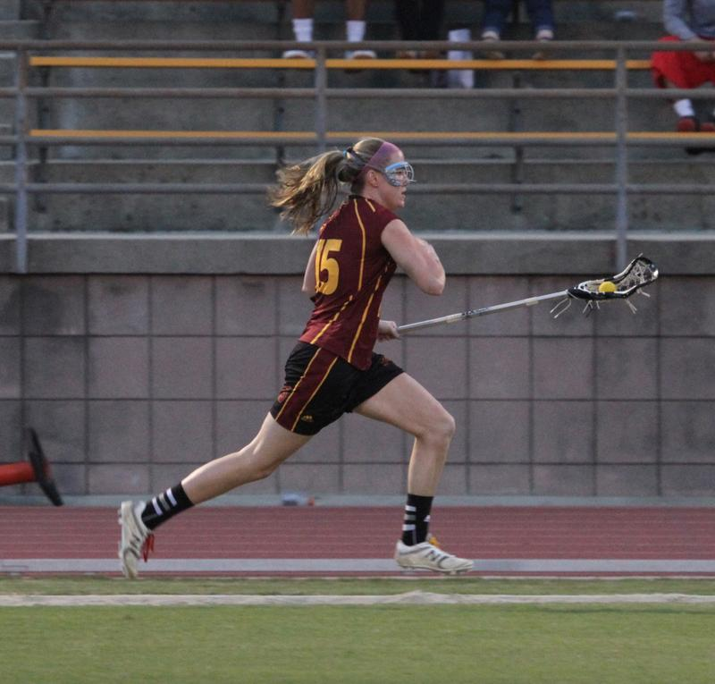 Junior midfielder Kate Hanick sprints down the field during a 2013 game. The Yeowomen open their season on the road against Otterbein University March 8.
