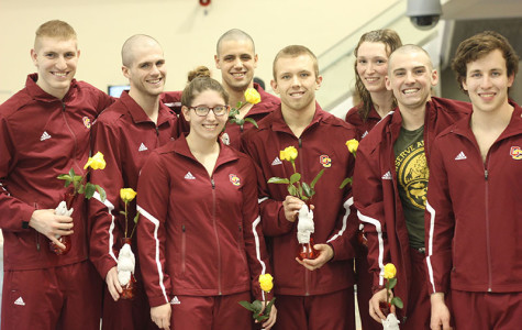 Seniors Jordan Attwood (left), Luke Harrison, Kelin Michael, Isaac Bacon, Robert McConkey, Katie Dunn, Chris Pickens and Rhys Hertafeld celebrate senior night at their final home meet. The Yeowomen finished seventh, while the Yeomen finished fifth at last weekend's NCAC championships.