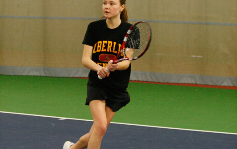 Junior Grace Porter eyes the ball inside the Heisman Club Field House. The women's tennis team is off to a 1–2 start this season.