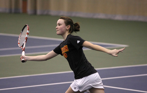 Junior Grace Porter lunges for the ball inside the Heisman Club Field House. The Yeowomen will have their first match this weekend at home against Baldwin Wallace University.