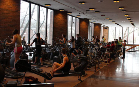 Students and community members utilize the equipment on the second floor of Philips gym. The new gym, which is located in the basement of South Hall, will open this Saturday.