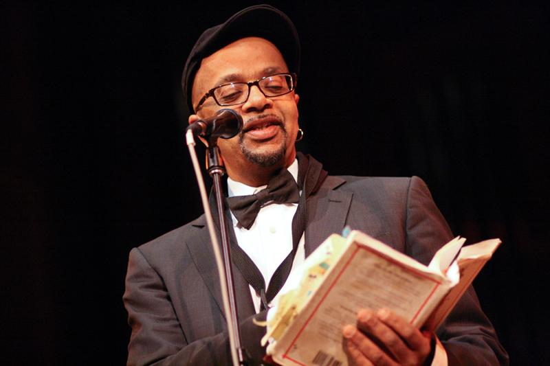 """James McBride, OC '79, imparts wisdom to the audience in a quiet moment at Wednesday's uplifting convocation. McBride, a novelist and musician, read excerpts of his novel The Good Lord Bird and played saxophone during the rousing musical interludes provided by his talented musical ensemble (not pictured), nicknamed """"The Good Lord Bird Band."""""""