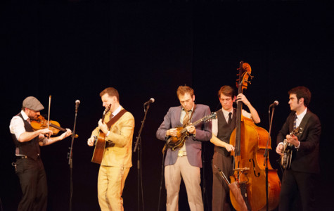 (From left) Punch Brothers members Gabe Witcher on violin, Chris Eldridge, OC '04, on guitar, frontman Chris Thile on mandolin, Paul Kowert on double bass and Noam Pikelny on banjo lock into a rhythm during their Artist Recital Series performance in Finney Chapel Sunday night. The bluegrass group demonstrated their talent and chemistry, but focused on diversity of repertoire at the expense of crowd-pleasing favorites.
