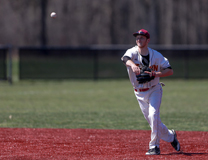 Junior Mitch Novak fires the ball toward first base in a game at Dill Field. Novak is second on the team with 22 RBIs.