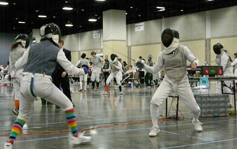Captain and sophomore Izzy Esler (left) duels an opponent during a tournament in Knoxville, TN. The women's Flaming Blades squad placed 19th out of 31 teams.