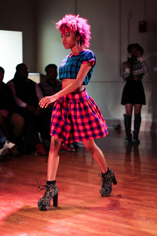 College first-year Mee-Ae Chatman-Nelson models a piece from sophomore Sophie Umazi Mvurya's fashion collection in the sold-out show Runway Through Africa. The event raised over $750 for the Yakubu Saaka Scholarship Fund, which aims to fully cover the tuition of an African student.