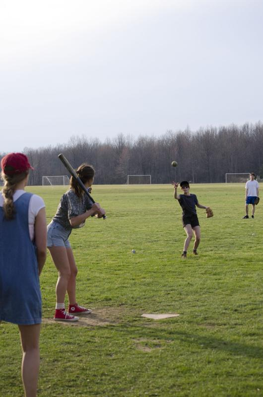 Junior+Sophie+Harari+eyes+a+pitch+in+an+intramural+softball+game+last+Monday.+Intramural+softball+allows+students+of+all+abilities+to+compete+in+a+friendly%2C+team-oriented+atmosphere.