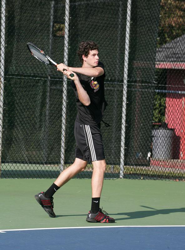 Junior Soren Zeliger serves the ball in a match earlier this season. The men's tennis team finished 3–4 in its spring break matches.