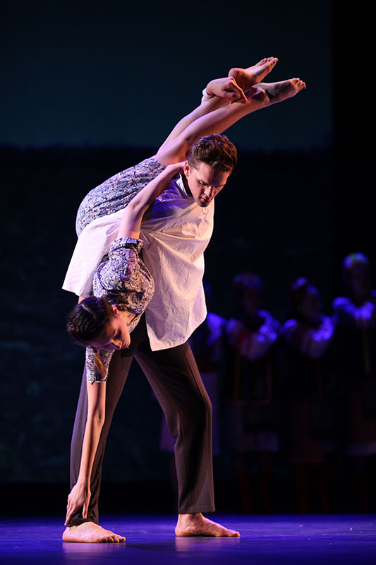"""College junior Christopher McLauchlan lifts College sophomore Rachel Nesnevich during """"Now We Are Here,"""" choreographed by Professor of Dance Nusha Martynuk. """"Now We Are Here"""" was featured as part of last Friday and Saturday's Oberlin Dance Company showcase, 'Other Worlds.'"""