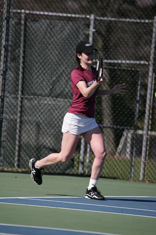 Senior Brenna Sheldon eyes the ball in a match. Sheldon boasts an impressive 21–6 singles record and 20–7 in dou- bles. She recently earned a bid to the NCAA Division III ten- nis tournament.