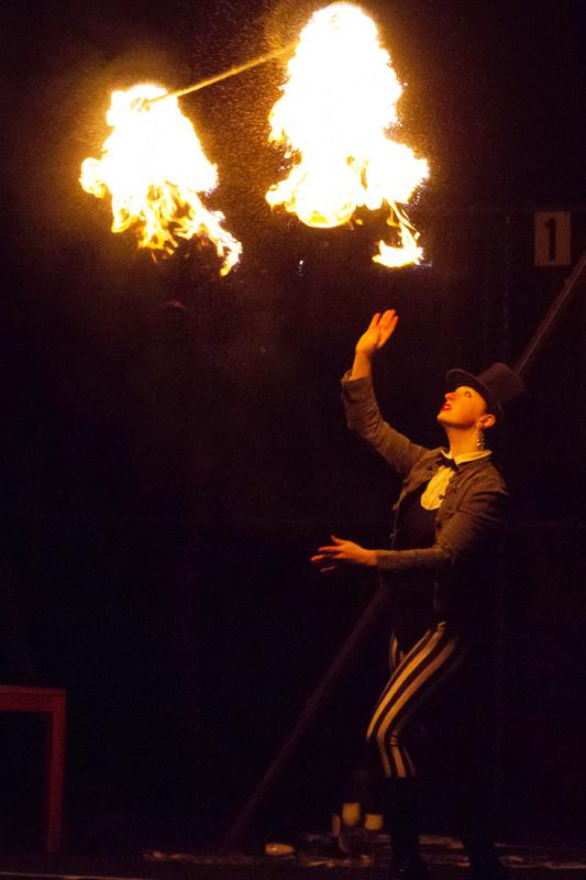 College+senior+Sam+Karpinski+tosses+a+fire+staff+into+the+air+in+one+of+the+many+fire+displays+of+last+Friday+and+Saturday%E2%80%99s+performance+of+Up+In+Smoke.+As+suggested+by+the+title%2C+Up+In+Smoke+branched+out+from+usual+OCA+shows+by+incorporating+many+fire+elements%2C+including+flaming+poi+and+fire-eating.