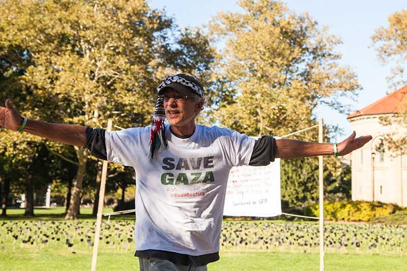 Cleveland resident Don Bryant speaks against Israeli occupation at a demonstration on Wednesday. SFP planted black flags in Wilder Bowl to call attention to the lives lost in Operation Protective Edge.
