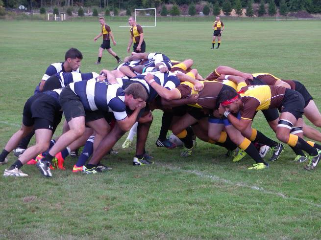 The forwards of the men's club rugby team ruck over the ball in a game last Saturday against Baldwin Wallace University. The team fell 28–11 in the match.