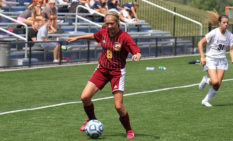 First-year Hannah Cook controls the ball in a game this season. Cook was named NCAC Player of the Week for her efforts last week and currently leads the team with four goals.