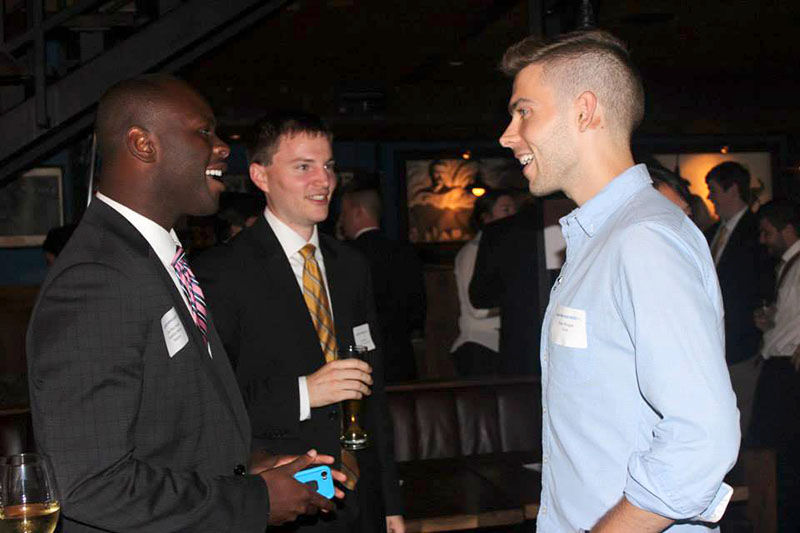 Luke Squire, OC '11, (center) converses with Councilman Marcus Madison (left) at the Celebrating Young Leaders in Politics event in Washington, D.C. Squire, along with Poy Winichakul, OC '11, recently founded a political action commit- tee which aims to urge young, progressive candidates to run for office.