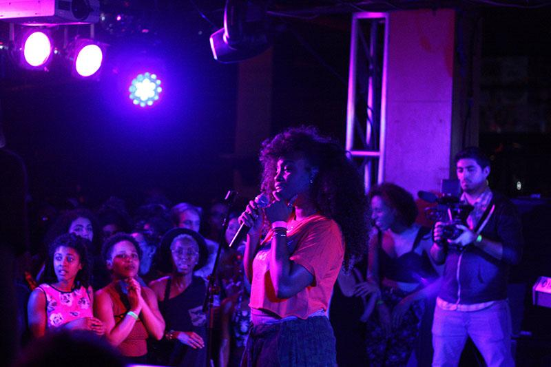 """SZA's laid-back vibe and confident stage presence satisfied concert-goers. Her show sold out well before she took the 'Sco stage last Friday night to perform hits from her Liam McLean Staff Writer Bryan Eubanks, despite what some lis- teners may assume, does not aim to trans- gress. His intention is not to push boundar- ies. Instead, he describes his development as an electronic artist as an organic evolu- tion from his original work with acoustic instruments — primarily the soprano sax- ophone — to his current style, an elusive concoction of trance-like electronics, inte- grated acoustic sounds and ambient noise. Beginning at 8 p.m., Fairchild Chapel's resonant dome became an echo chamber for a zealous hubbub of around 30 stu- dents. Two tables supported an eclectic ar- ray of electronic instruments. The front ta- ble was reserved for Eubanks and boasted an open-feedback synthesizer, a computer for samples and a transducer, a device that channels frequency through a metal plate to produce sound. The rear table was set up for William Johnson, a double-degree sophomore pursuing majors in Studio Art and TIMARA, who opened the eve- ning with a performance using a modular synthesizer. Johnson began with an improvisational performance involving synthesized drones and wails. The more unsettling elements induced visible wincing and ear-plugging among the crowd. His work seemed to capitalize more on sonic """"shock value"""" than anything; the music lacked build, and the hellish din that exploded in the middle of the piece was gratuitous. The perfor- mance's saving grace was a single descend- ing riff, the only melodic portion of the per- formance — and a surprisingly infectious one at that — which added a sense of cohe- sion to the chaos. Following a brief intermission in the whiplashed aftermath of Johnson's perfor- mance, Eubanks took the stage, command- ed the attention of the audibly excited crowd with an unassuming, """"Hey,"""" and pro- ceeded to fill the room with his uniquely """