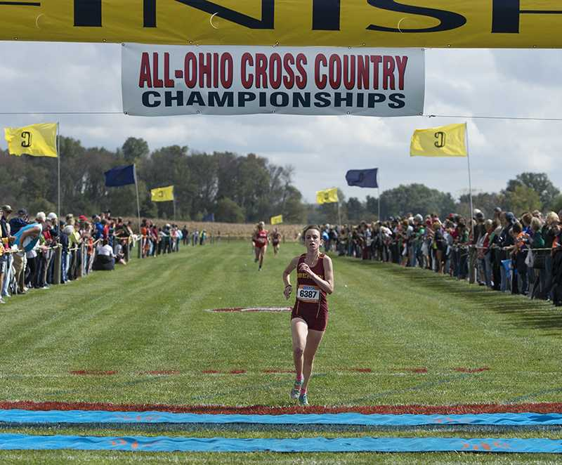 Senior Emma Lehmann crosses the finish line at last Friday's All-Ohio Championships. Lehmann finished first in the race, making her the top female runner in Ohio.