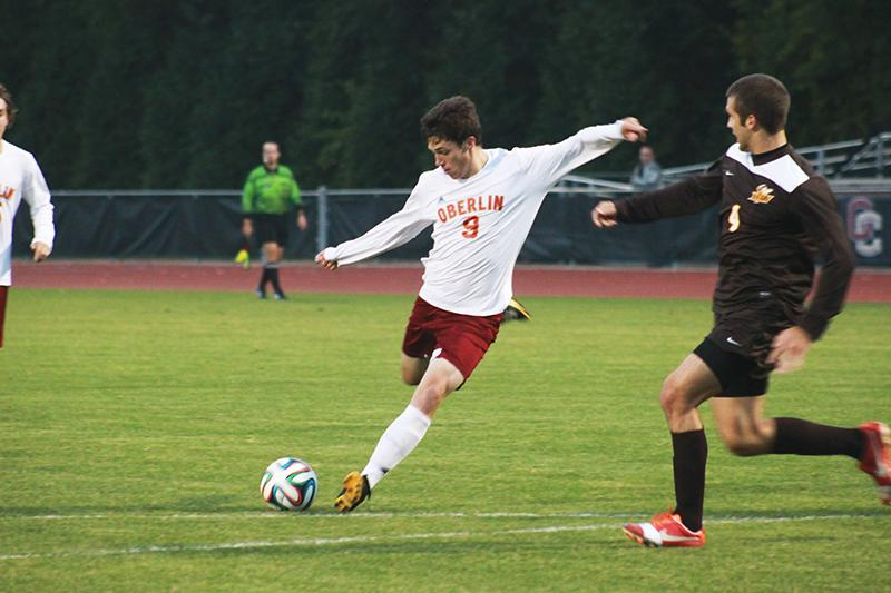 Junior John Ingham serves the ball in a game against the Wittenberg University Tigers last Saturday. The Yeomen won the game on a second-half goal by sophomore Dan Lev.