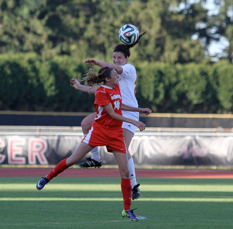 First-year Josie Marshall goes up for a header against an opposing defender. The Yeowomen are currently on an eight-game winning streak.