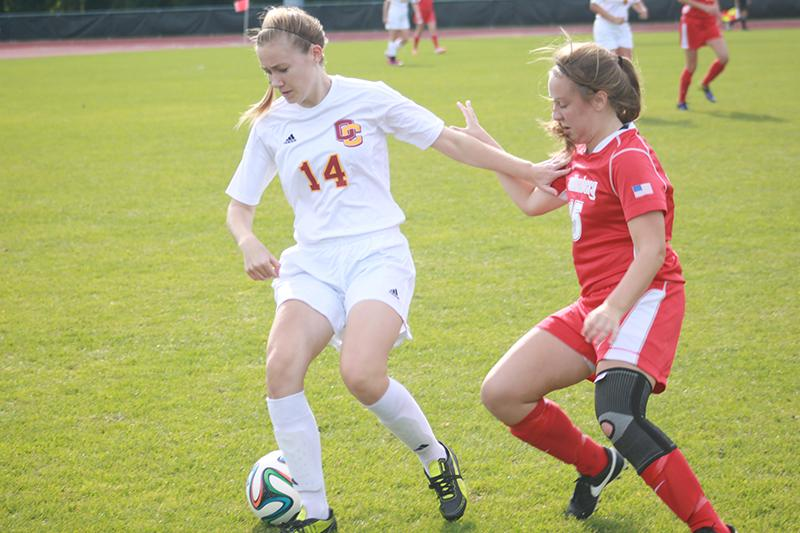 Junior Ellie Huizenga dribbles past a Wittenberg defender in a 2–1 double-overtime victory last Saturday. The Yeowomen have won eight consecutive games.