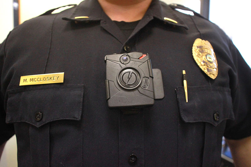 Lt. Mike McCloskey poses with one of the Oberlin Police Department's new body cameras. McCloskey said he hopes the camera will pre-emptively improve the officer's relationship with the public and decrease thenumberofpubliccomplaints.