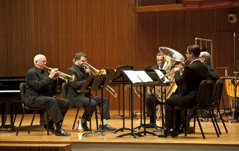 "A brass quintet performs Lutosławski's ""Mini Overture"" in Warner Concert Hall. Associate Professor of Trumpet Roy Poper (left), Assistant Professor of Trombone Lee Allen, Visiting Professor of Tuba Denis Nulty, Professor of Horn Roland Pandolfi and Trumpet major and Conservatory senior Luke Spence played with precision and poise during this installment of the Faculty Chamber Series."