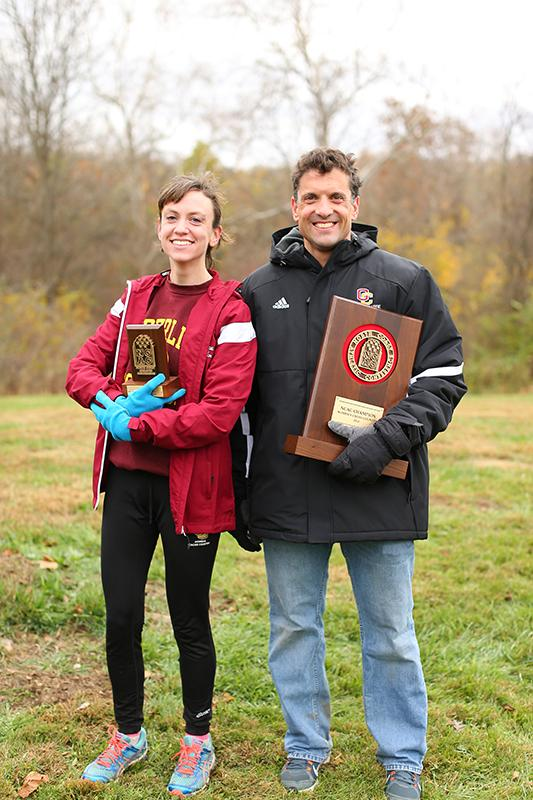 Senior Emma Lehmann (left) and Cross Country Coach Ray Appenheimer pose for a picture after the North Coast Athletic Conference championships. Lehmann finished first in the 6K race.