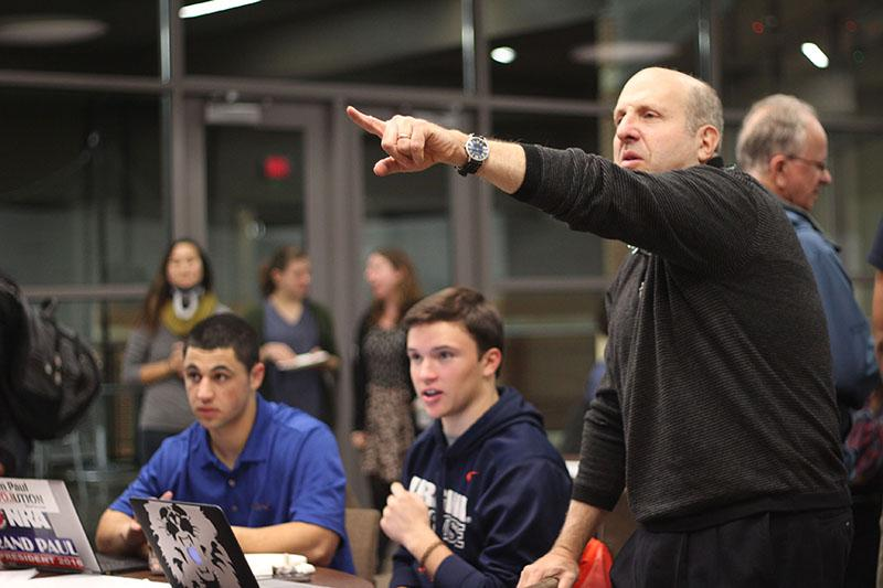 President Marvin Krislov anxiously watches the midterm election returns with College first-years Dan Marcelle and Daniel Pardee. This year's elections saw success across the board for the Republican Party, which swept both Ohio and the rest of the country.