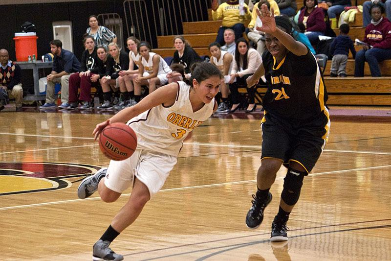 Junior guard Lindsey Bernhardt dribbles past an Adrian College Bulldogs defender last Wednesday. Bernhardt scored 17 points and led the Yeowomen to a 68–59 victory.