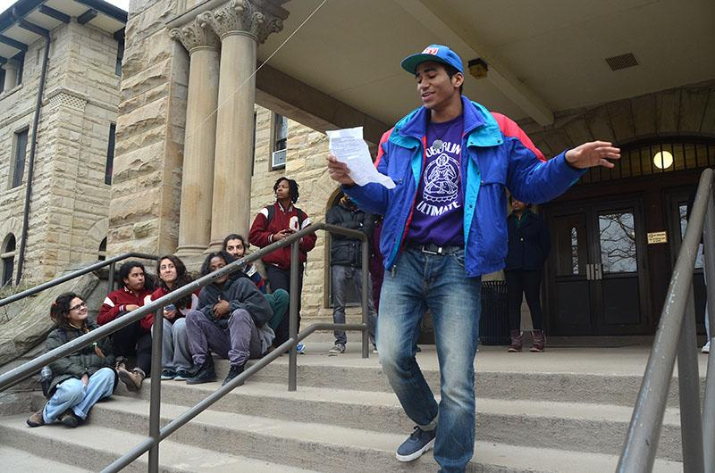 College first-year Justin Jimenez performs an original rap in front of Wilder Hall. Roughly 200 students gathered in front of Wilder Saturday to attend an emergency convocation where students demanded the administration  take action to support students who have been disproportionately affected by recent accounts of police brutality nationwide.