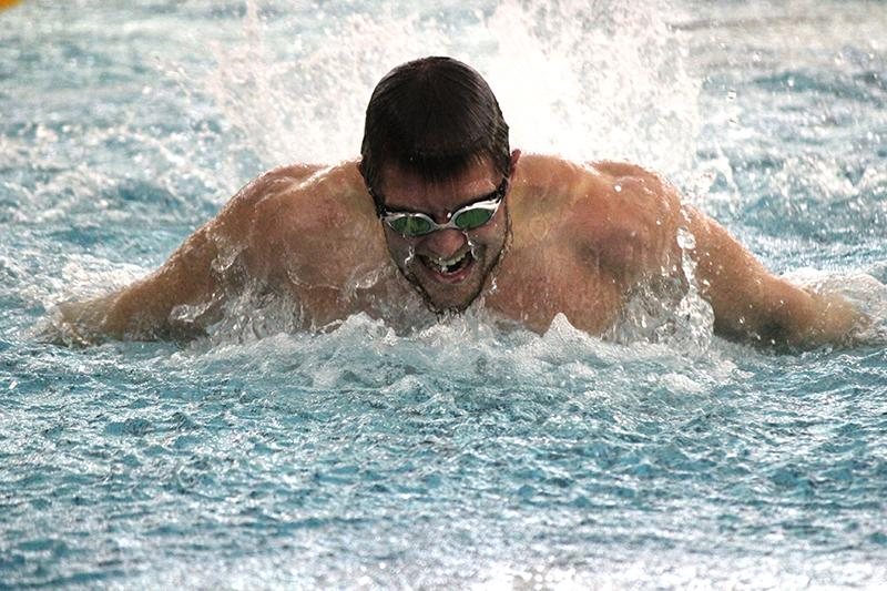 Senior co-captain Jack Redell swims the butterfly in a home meet against the John Carroll University Blue Streaks on Jan. 17. The swimming and diving team concludes its season with the NCAC Championship, which begins next Wednesday in Granville, OH.