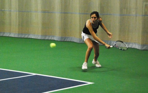 First-year Mayada Audeh returns a shot in her match against the visiting Ashland University Eagles on Wednesday. Audeh won both her matches in the No. 1 doubles and No. 2 singles slots to bring her total career wins to six.