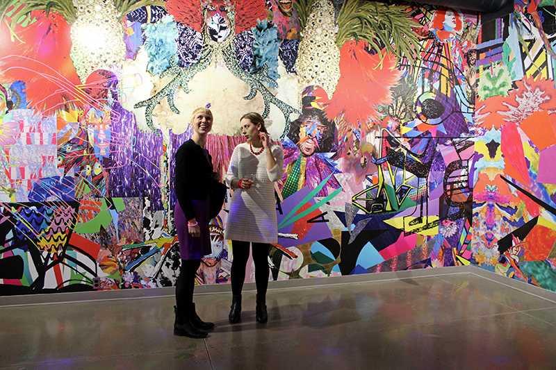 Two attendees gaze at installation artist Eli Sudbrack's work. The Allen Memorial Art Museum premiered its exhibition of Sudbrack's art last Friday.