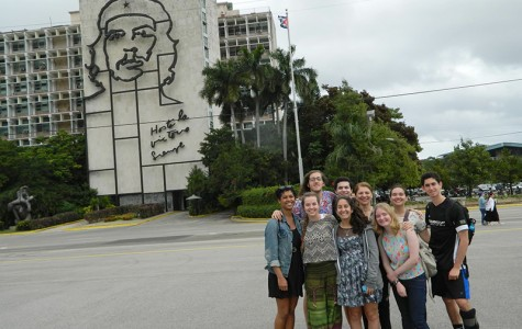 The group stands in the Plaza de la Revolución in Havana, Cuba. Over the course of two weeks, the students traveled to several different parts of Cuba and chatted with residents.