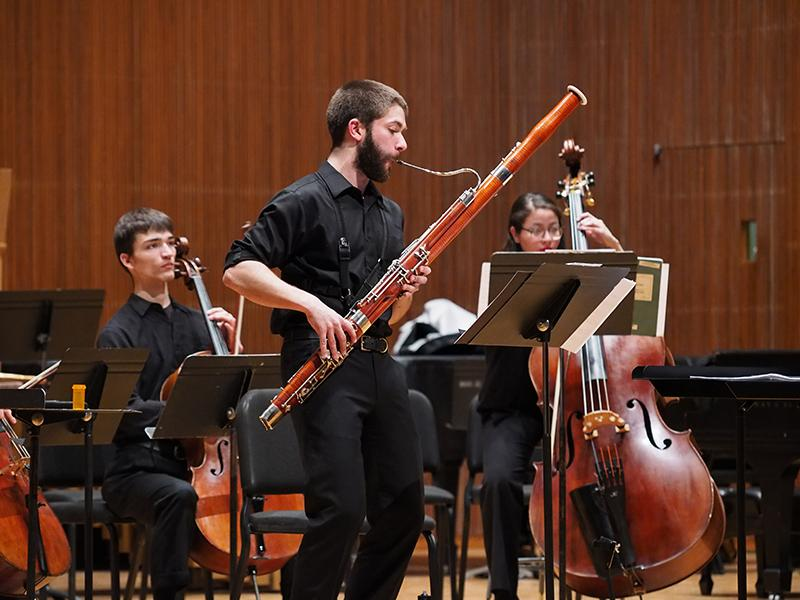Conservatory senior Ben Roidl-Ward performs as part of the Contemporary Music Ensemble. Roidl-Ward took center stage as a featured soloist in Sofia Gubaidulina's Concerto for Bassoon and Low Strings at a concert in Warner Concert Hall this past Friday.