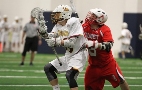 Junior attacker Nick Lobley looks to work around a defender in the team's season opener against the Olivet College Comets. Lobley leads the 2–0 Yeomen with seven goals