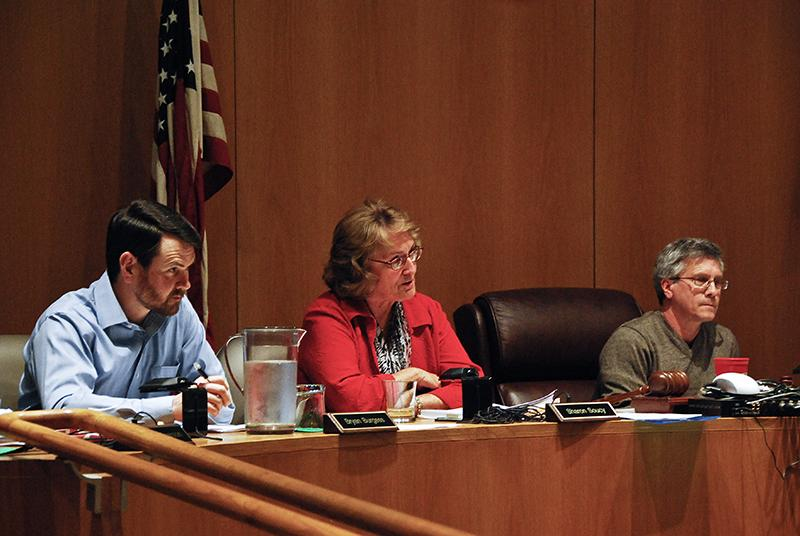 Council member Bryan Burgess, Council Vice President Sharon Fairchild-Soucy and Council President Scott Broadwell participate in a Council meeting on Monday. At the meeting, Council, divided between those who think City Manager Eric Norenberg should be replaced and those who believe he should stay, decided not to release its goals for Norenberg.