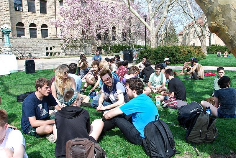 Students gather in small groups during a meeting last Saturday to plan a response to the rise in tuition. The groups drafted a series of demands that they feel would make the school more financially accessible.
